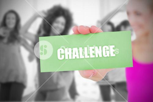 Fit blonde holding card saying challenge