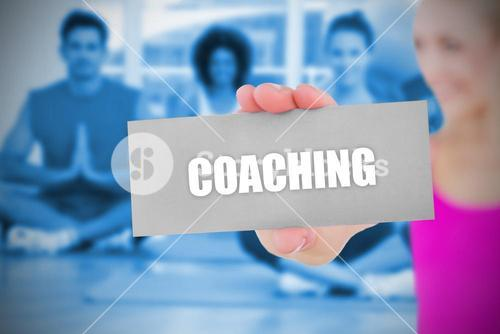 Fit blonde holding card saying coaching