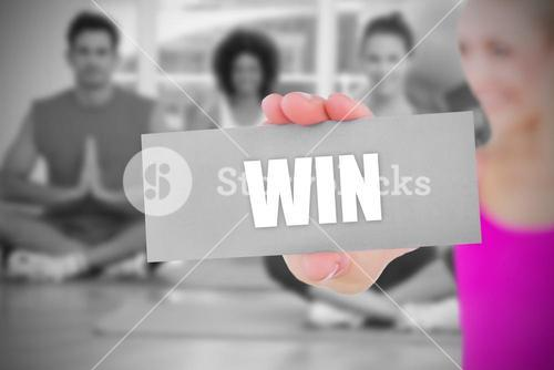 Fit blonde holding card saying win