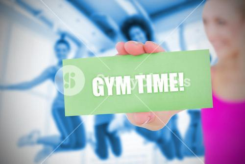 Fit blonde holding card saying gym time