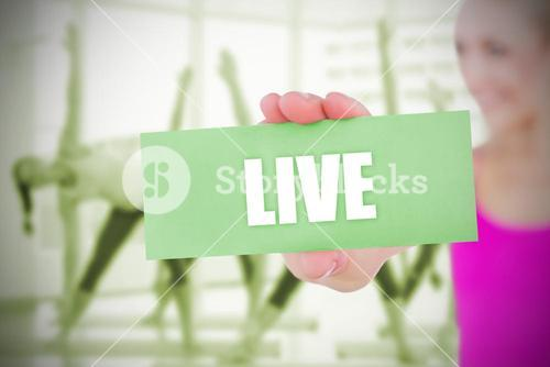 Fit blonde holding card saying live