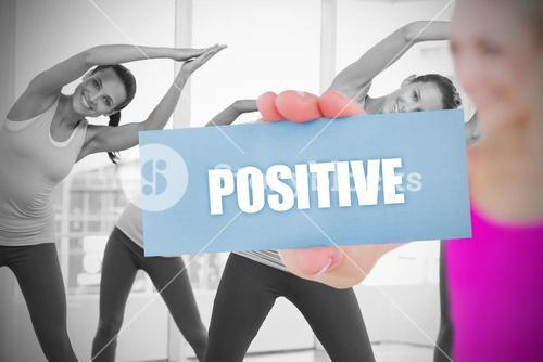 Fit blonde holding card saying positive