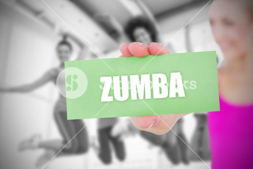Zumba against fit blonde holding pink card