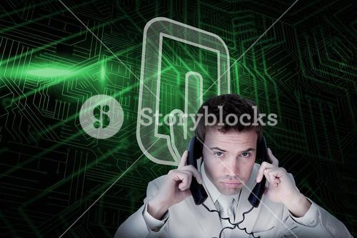 Composite image of tablet pc and businessman tangled in wires