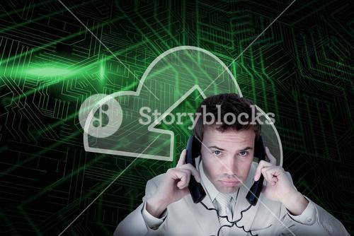Composite image of cloud computing and businessman tangled in wires
