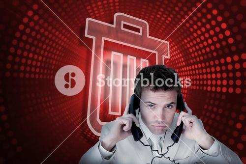 Composite image of trash can and businessman tangled in wires
