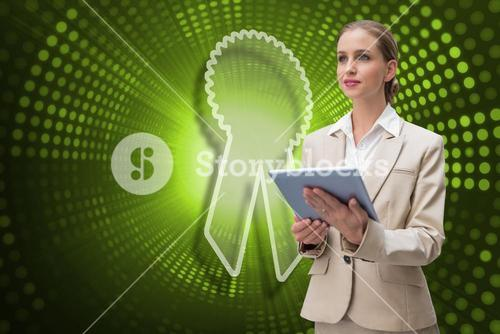 Composite image of merit badge and businesswoman using tablet