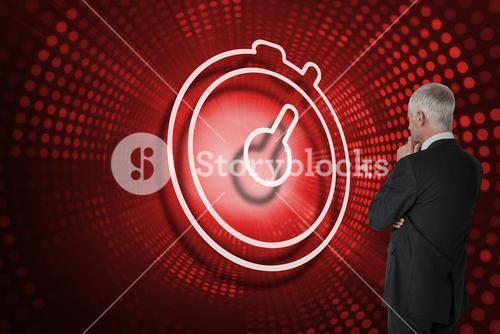Composite image of stopwatch and businessman looking