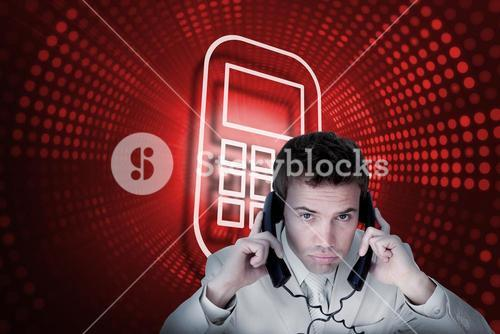 Composite image of smartphone and businessman tangled in wires