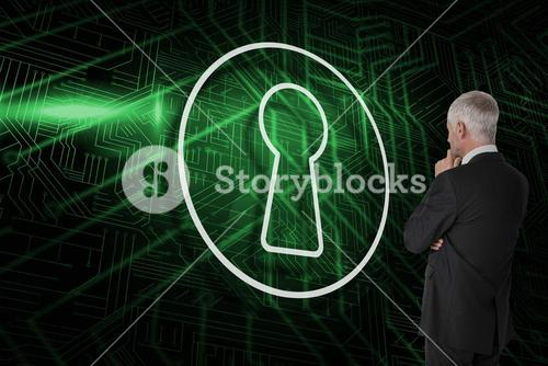 Composite image of keyhole and businessman looking