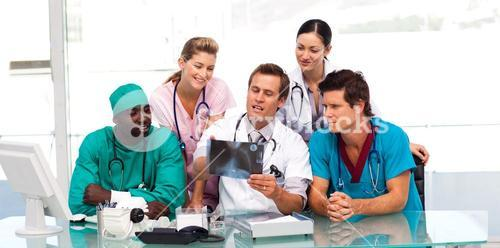 Group of doctors examining an Xray