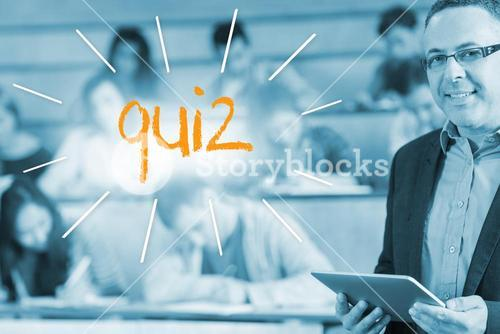 Quiz against lecturer standing in front of his class in lecture hall