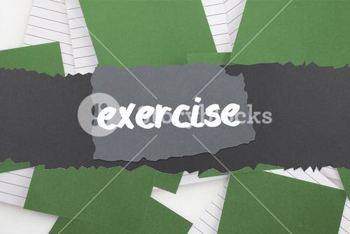 Exercise against green paper strewn over notepad