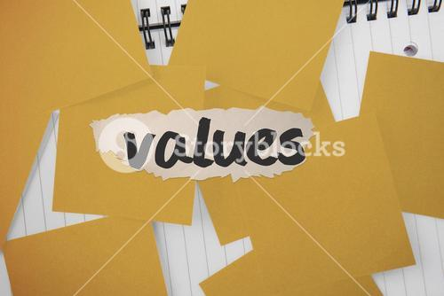 Values against yellow paper strewn over notepad
