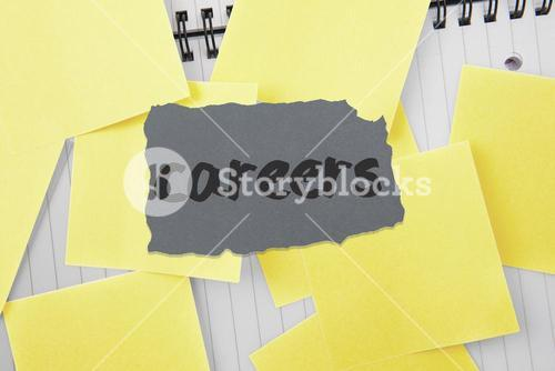 Careers against sticky notes strewn over notepad