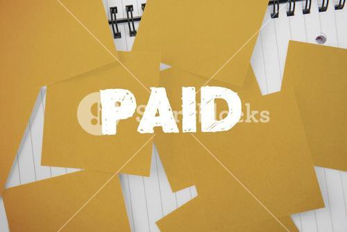 Paid against yellow paper strewn over notepad