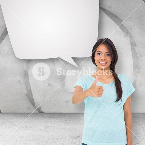 Composite image of happy brunette giving thumbs up