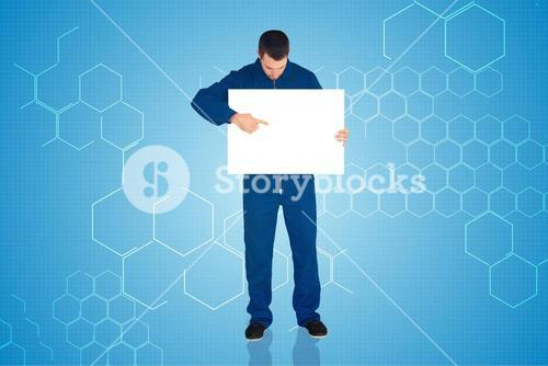 Composite image of handsome mechanic showing card