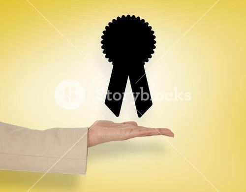 Composite image of female hand presenting merit badge
