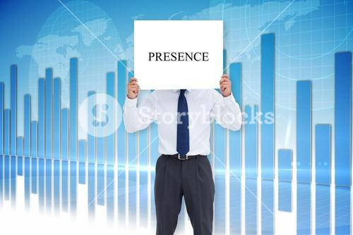 Businessman holding card saying presence