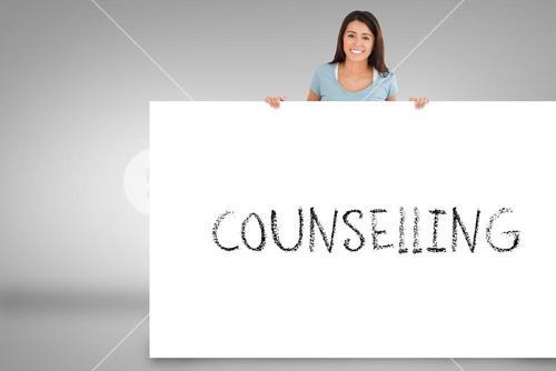 Pretty brunette showing card with counselling