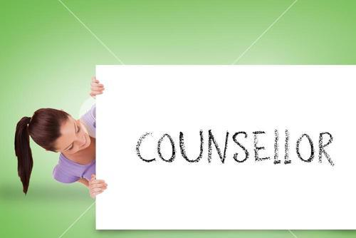 Pretty brunette showing card with counsellor