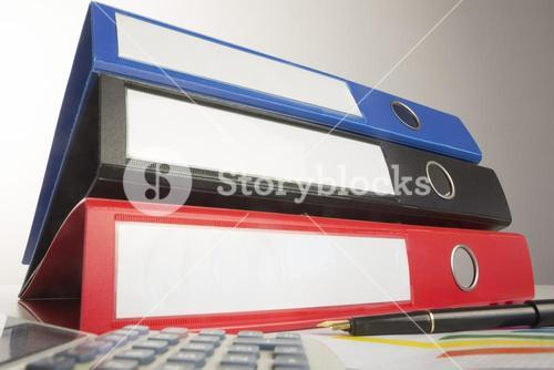 Stack of three business binders