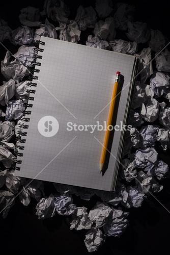 Graph paper notebook with pencil