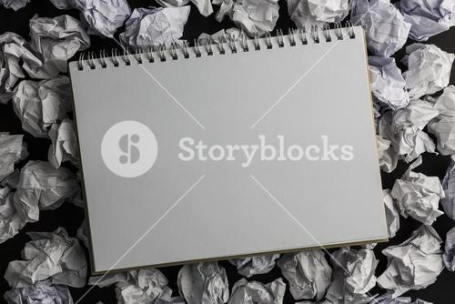 Paper notebook on crumpled paper