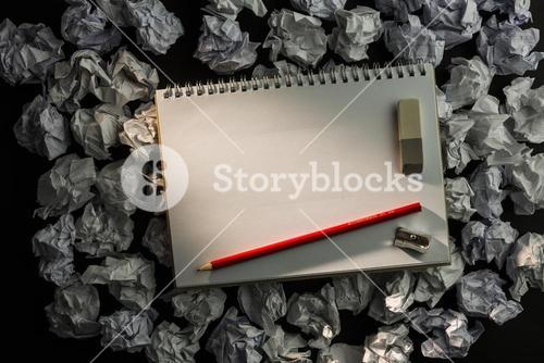 Paper notebook with pencil eraser and parer