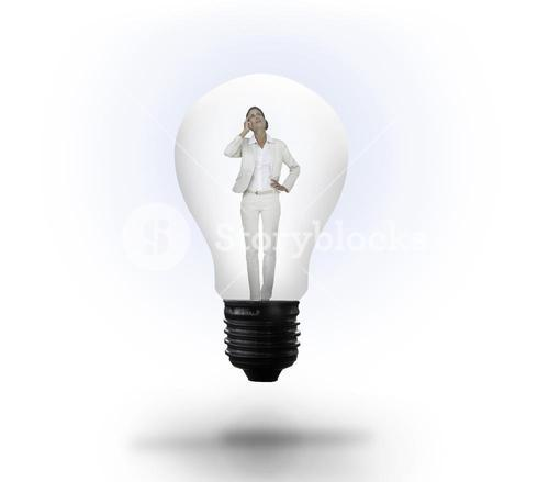 Thinking businesswoman in light bulb