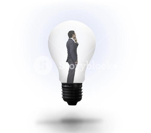 Thinking businessman in light bulb