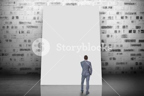 Composite image of thinking businessman