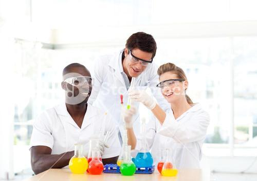 Group of scientists examining testtubes
