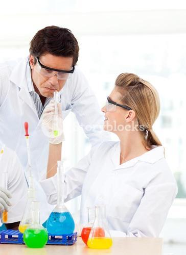 Scientists studying testtubes