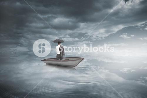 Composite image of businessman standing back to camera in a sailboat