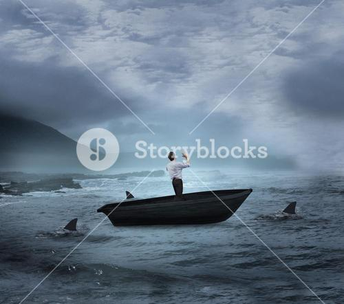 Composite image of businessman posing with arms up in a sailboat