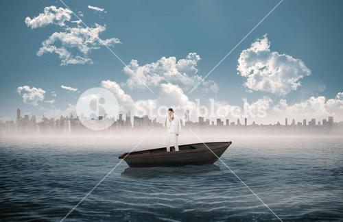 Composite image of thinking businesswoman in a sailboat