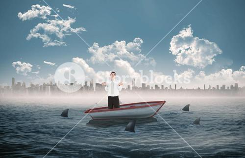 Composite image of portrait of a clueless businessman posing in a sailboat