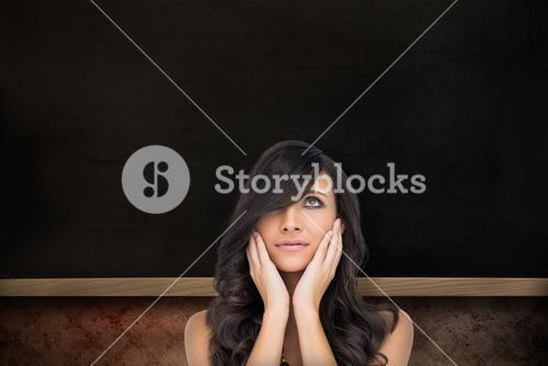 Composite image of anxious brown haired model posing holding her head