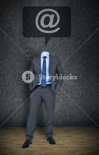 Headless businessman with at sign in speech bubble