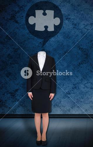 Headless businesswoman with jigsaw in speech bubble