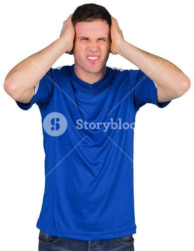 Disappointed football fan in blue