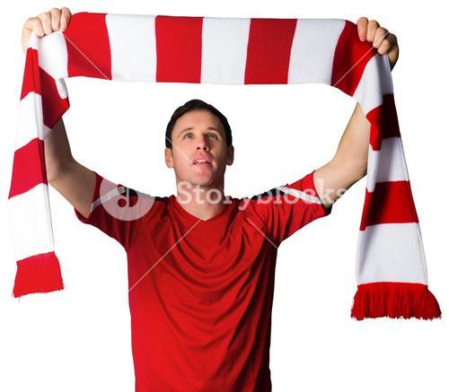 Football fan in red holding scarf