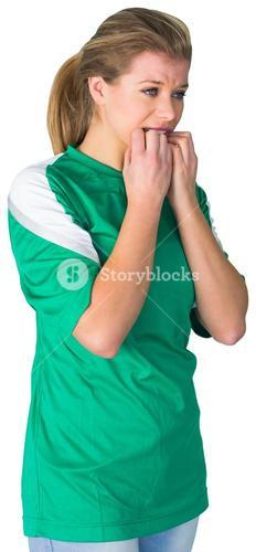 Nervous football fan in green