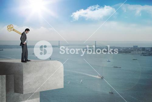 Composite image of wound up businessman with hands on hips