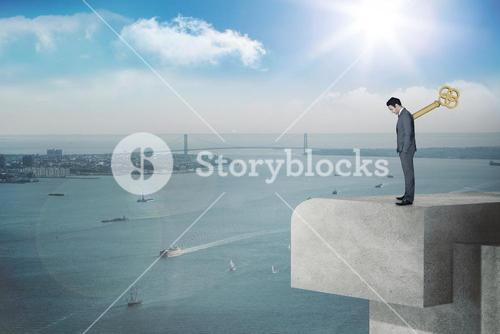 Composite image of wound up businessman with hands in pockets