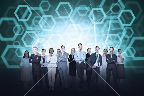Business team against hexagon background