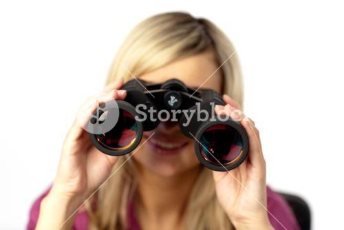 Delighted woman using binoculars