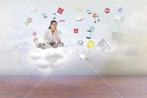 Composite image of businesswoman sitting cross legged thinking